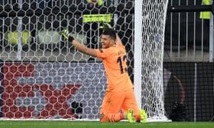 Villarreal's Geronimo Rulli celebrates saving Manchester United goalkeeper David de Gea's penalty.
