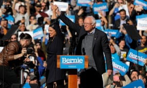 Alexandria Ocasio-Cortez introduces Bernie Sanders at Queensbridge Park in New York City.