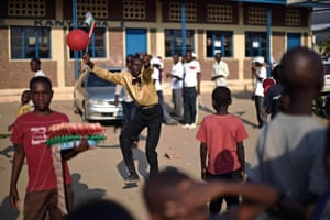 A man dances at a rally for Burundi's ruling CNDD-FDD party in Bujumbura. Parliamentary polls, in which president Pierre Nkurunziza's CNDD-FDD scored a widely-expected landslide win, were held on 29 May but boycotted by the opposition and were condemned internationally. Presidential elections are due to be held in the country next week and opposition groups say that if Nkurunziza seeks another term, it would violate a peace deal that paved the way for an end to a dozen years of civil war in 2006.