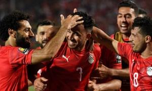 Mohamed Salah (left) and midfielder Tarek Hamed (right) congratulate Trezeguet on scoring the winning goal