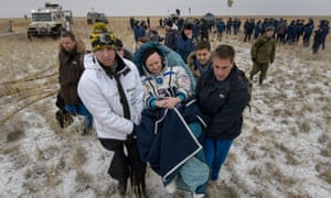 Scott Kelly is carried into a medical tent after he and Russian cosmonauts Sergey Volkov and Mikhail Kornienko landed in their Soyuz spacecraft in a remote area of Kazakhstan on Wednesday.