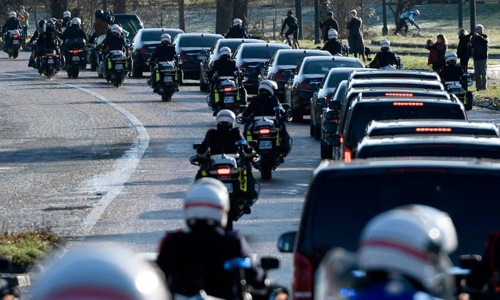 The funeral cortege makes its way through Paris
