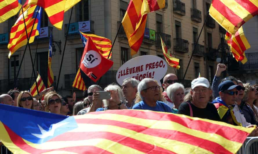 People take part the in a march with several mayors of Catalonia in Barcelona on 16 September to support the region's independence referendum.