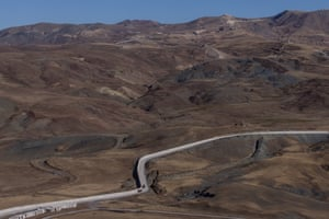 Military vehicles patrol along a newly completed section of a wall along the border between Iran and Turkey.