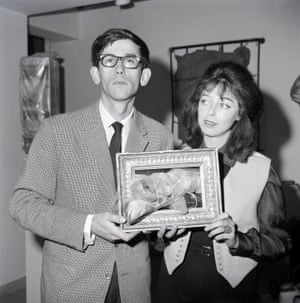 1963, Rome. Christo and Jeanne-Claude holding artwork.