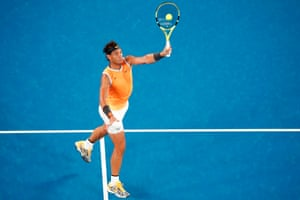 Rafael Nadal smashes the ball back to Matthew Ebden.