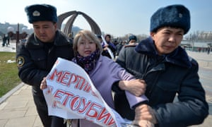 A protestor in Kyrgyzstan is arrested.