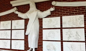 A statue of Jesus and reliefs at Red Bank Baptist Church in Lexington, South Carolina, which faces removal.