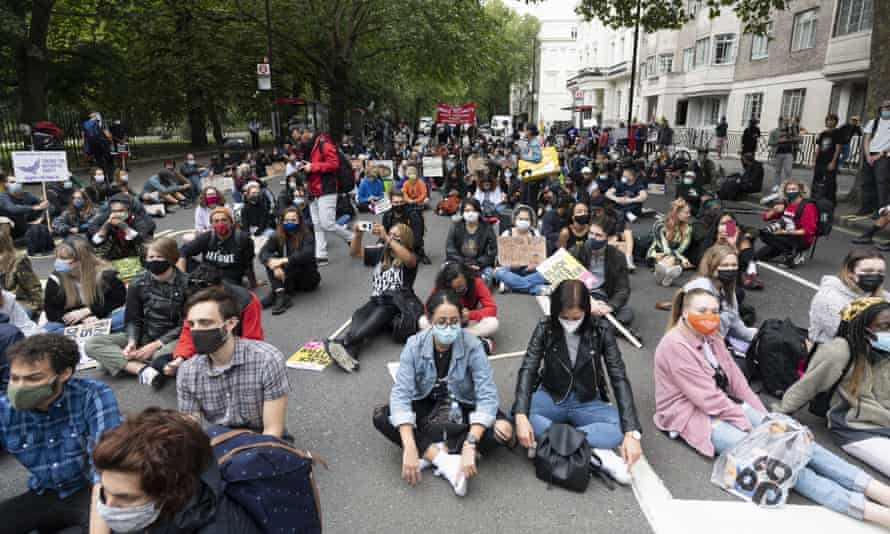 Protesters stopping to sit in the road during the Million People March demonstration in London on 30 August