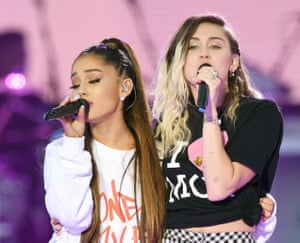 Ariana Grande, left, and Miley Cyrus perform at the One Love Manchester tribute concert in Manchester,