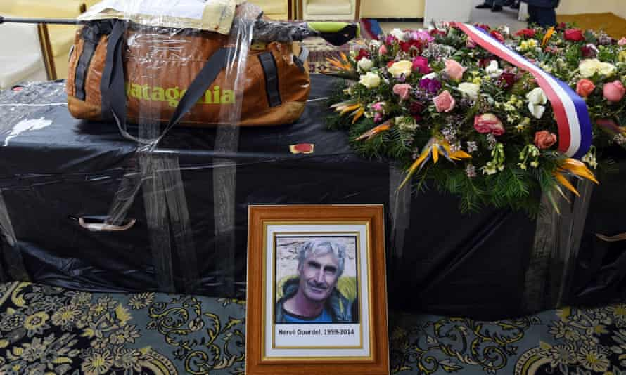 The backpack of Herve Gourdel sits on his coffin before it is flown to Paris in 2015.
