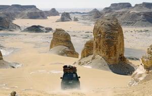 Desert safari vehicles in the Aqabat desert