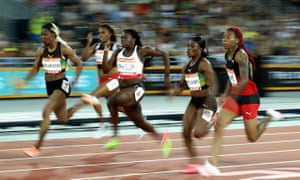 Michelle-Lee Ahye of Trinidad and Tobago, right, powers towards the line to win gold in the women's 100 metres final.