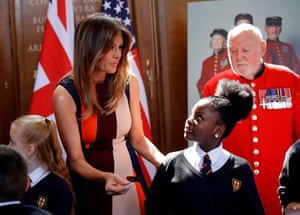 Day 2: Melania helps children make poppies during her visit
