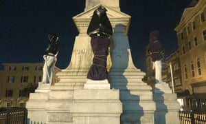 The Confederate monument is covered in bags in Portsmouth, Virginia.