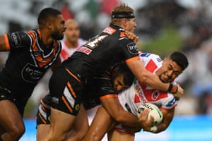 Timoteo Lafai of the St. George Illawarra Dragons is tackled by Alex Twal and Luke Garner of the Wests Tigers during their Australian National Rugby League match at WIN Stadium, Wollongong
