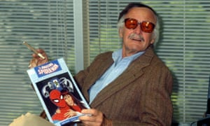 Stan Lee in 1990 with a copy of The Amazing Spider-Man.