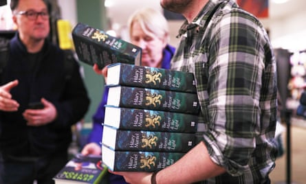 A bookseller hands out copies of Hilary Mantel's book The Mirror & the Light at Waterstones in London