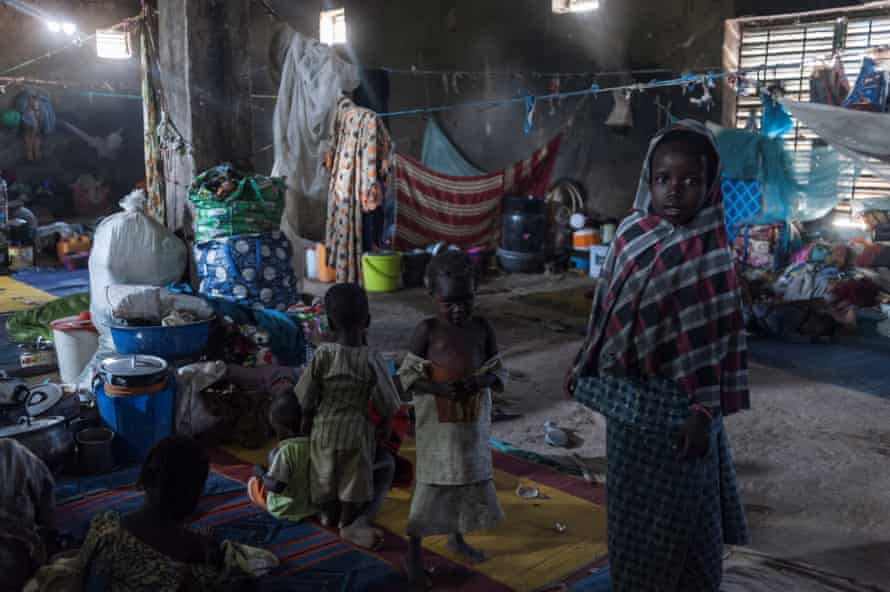 Children take refuge from the sun inside a warehouse made available for internally displaced people in Maiduguri, north-eastern Nigeria.