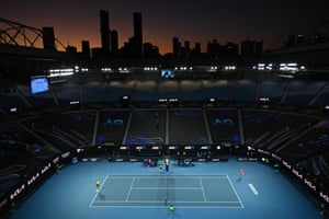 Stefanos pictured serveing to Nadal against Melbourne's city skyline.