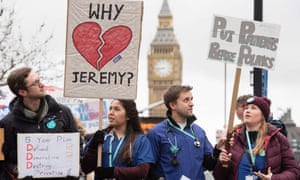 Junior doctors protest with banners outside St Thomas' hospital in central London in March.