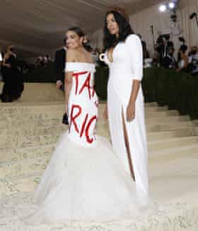 Alexandria Ocasio-Cortez and the designer Aurora James arrive at the Met Gala.