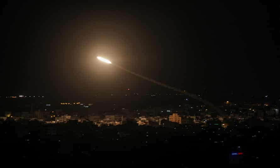 A rocket fired from Gaza flies towards Israel.