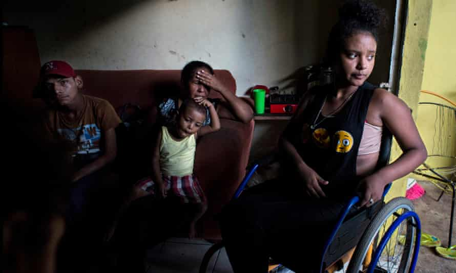 Janet Machado, center, fled Honduras with her family after her 14-year-old daughter Gabriela, right, was shot in the shoulder and left paralysed.