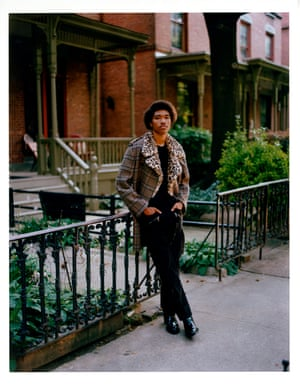 Coat, £1,615, and trousers, £630, Neil Barrett. T-shirt, £30, Asket. Boots, £750, Jimmy Choo. All jewellery, model's own.Grooming: Sasha Nesterchuk at The Club New York using Dior and Kerastase. Stylist's assistant: Lucy Gaston. Photographer's assistant: Joey Abreu. Model: Jonny Uptown at Akrav Agency. Casting: Akrav Casting
