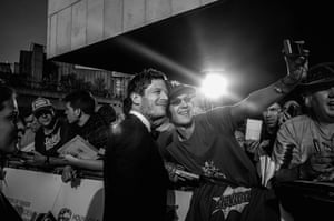 James Norton takes a selfie with a fan on the red carpet