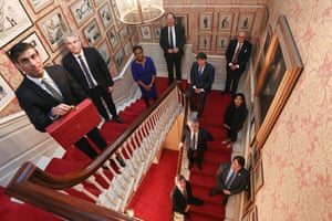 Rishi Sunak (left) posing with the budget red box on a staircase at 11 Downing Street with this team: chief secretary to the Treasury Steve Barclay, exchequer secretary to the Treasury Kemi Badenoch, financial secretary to the Treasury Jesse Norman, economic secretary to the Treasury John Glen, minister of state for Efficiency Theodore Agnew, Claire Coutinho, James Cartledge, Craig Williams (all PPSs) and David Rutley, a whip.