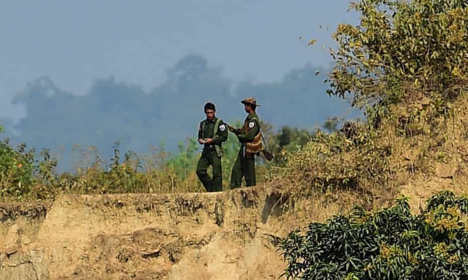 Myanmar soldiers patrol the Bangladesh border