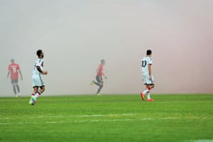 Hapoel Rubi Haifa fans throw smoke bombs onto the pitch during a match with rival team Hapoel Tirat Hacarmel