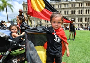 Children attend the rally in Brisbane with their families.