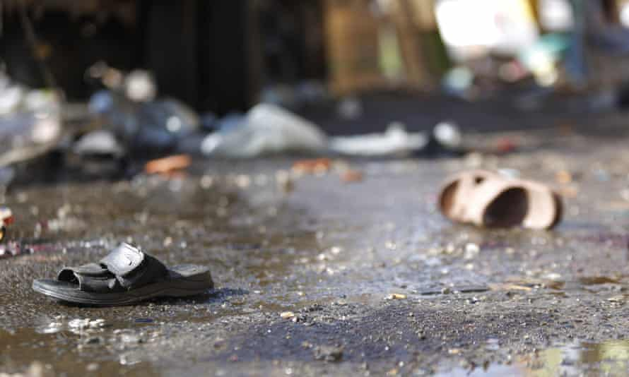 Sandals of victims lie on the ground, at the site of a suicide bomb attack in Sana'a.