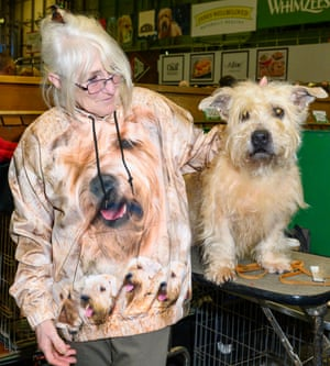 Woman wearing top that matches her dog, at Crufts dog show 2019