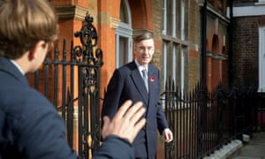 Jacob Rees Mogg leaves his home in Westminster, London, today, and meets Guardian journalist Simon Murphy