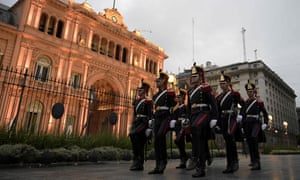 Argentine Grenadiers march to Casa Rosada government house after lowering the national flag at Plaza de Mayo square in Buenos Aires, Argentina on March 17, 2020.