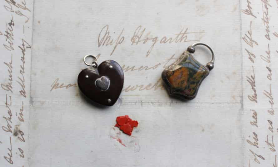 A heart-shaped locket owned by Mary Hogarth, containing a lock of her brother-in-law Charles Dickens's hair, and a silver locket, with moss agate stone, containing a lock of Hogarth's hair given to Dickens by his mother-in-law in 1837.
