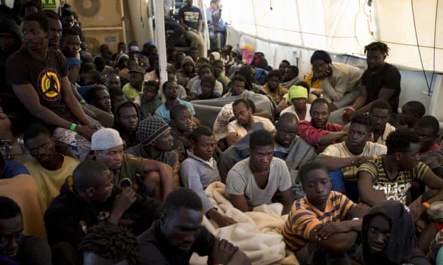 Migrants and refugees aboard the Golfo Azzurro after being rescued as they attempted to cross the Mediterranean Sea to Europe from Libya in June