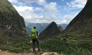 western tourist gazes at north vietnam hills