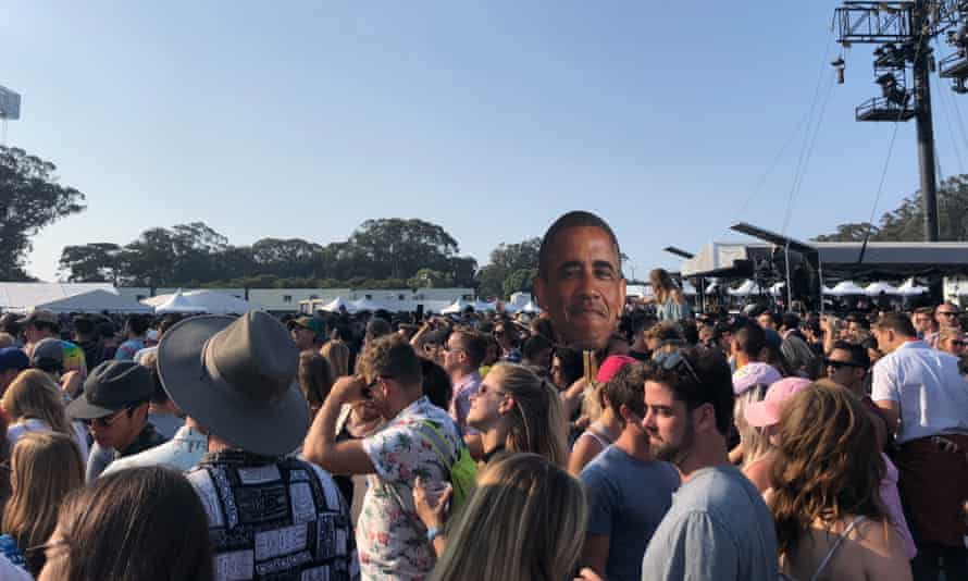 A cutout of Barack Obama floats above the crowd at San Francisco's Outside Lands music festival.