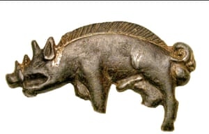 A late medieval silver boar badge from the Battle of Bosworth, complete except for the lower part of three of its four legs. The boar is seen in profile, facing left. It has an open mouth, long nose and prominent tusks; the ears are pointed and the left ear, closer to the viewer, has a recessed centre. A row of upright, slightly rear-pointing bristles runs all the way along the back from the thick neck to the curled-up tail