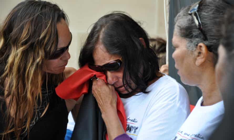 The mother of Ms Dhu is comforted by family at a protest against deaths in custody in 2014.