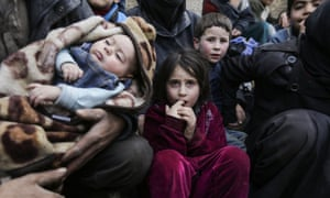 Syrian children wait to be evacuated from eastern Ghouta