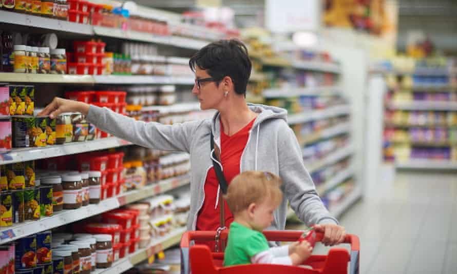 Young mother with a baby in a supermarket