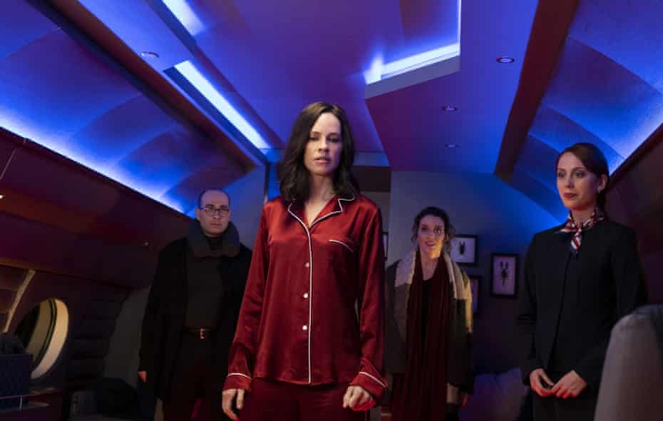 """Hilary Swank, center, in a scene from """"The Hunt."""" (Patti Perret/Universal Pictures via AP)"""