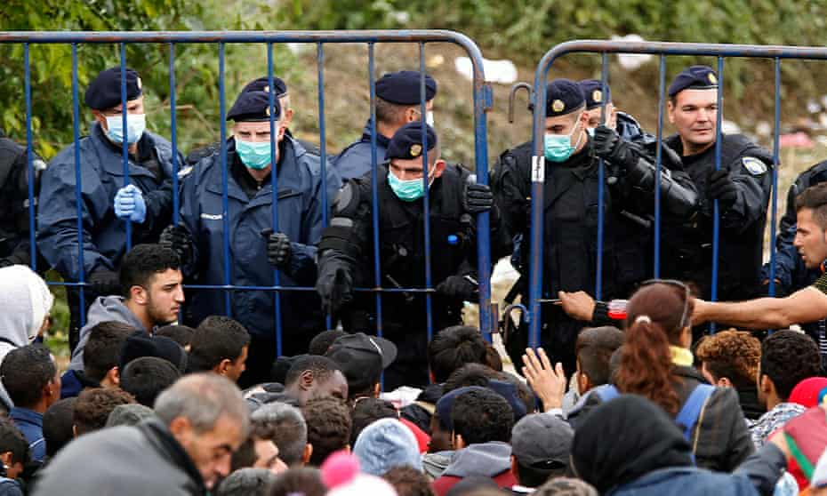 Croatian border police face refugees at the border with Serbia.