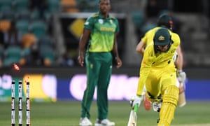 Australia's Alex Carey runs in safe as South Africa look for a run out.