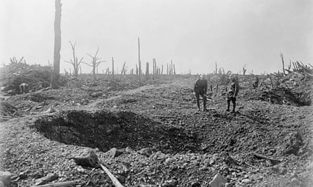 Soldiers are dwarfed by a shell crater on one of the roads to Bapaume during the Battle of the Somme.